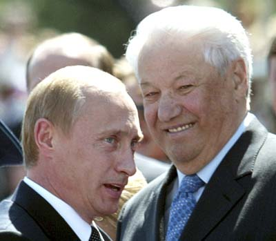 Russia's President Vladimir Putin speaks as former Russian president Boris Yeltsin (R) smiles in Moscow in this June 12, 2004 file photo. Yeltsin has died, according to Interfax April 23, 2007. REUTERS/Sergei Karpukhin/Files (RUSSIA)